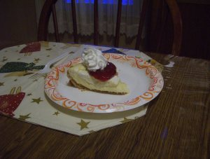 Double layer cheesecake with cherry topping and whipped cream